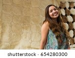 close up of a beautiful smiling ... | Shutterstock . vector #654280300