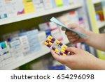 hand holding medicine capsule... | Shutterstock . vector #654296098
