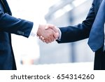 business partnership meeting... | Shutterstock . vector #654314260