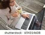 young woman drinking coffee and ... | Shutterstock . vector #654314608