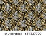 golden pattern on black... | Shutterstock . vector #654327700