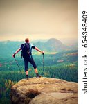 hiker backpacker reaches the... | Shutterstock . vector #654348409