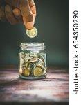people ' s hand  putting ten...   Shutterstock . vector #654350290
