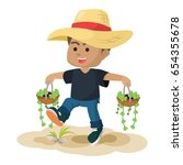 african boy carrying two plant | Shutterstock . vector #654355678