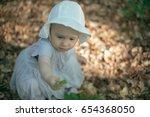 cute baby girl picking leaves...   Shutterstock . vector #654368050