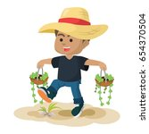 african boy carrying two plant | Shutterstock .eps vector #654370504
