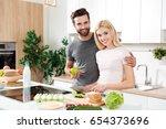 lovely couple embracing each... | Shutterstock . vector #654373696