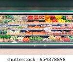 fresh vegetables on shelf in... | Shutterstock . vector #654378898