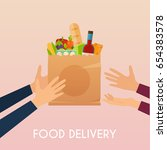 hand holding food in package.... | Shutterstock .eps vector #654383578