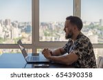 a guy with a beard working on a ... | Shutterstock . vector #654390358