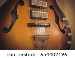 retro bass guitar in vintage... | Shutterstock . vector #654402196