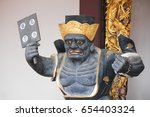 Small photo of THIAN HOCK KENG, SINGAPORE, JANUARY, 2015: black impermanence statue at Thian Hock Keng in Singapore