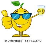 lemon fresh fruit with green... | Shutterstock .eps vector #654411640
