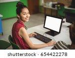 portrait of smiling schoolgirl... | Shutterstock . vector #654422278