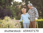 happy senior couple standing in ... | Shutterstock . vector #654437170