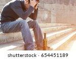 man depressed with wine bottle... | Shutterstock . vector #654451189
