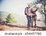 young couple with backpacks... | Shutterstock . vector #654457780