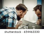 washing and refreshing face. | Shutterstock . vector #654463330