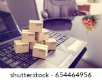 seven small paper boxes on a... | Shutterstock . vector #654464956