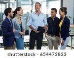 businesspeople having... | Shutterstock . vector #654473833
