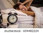 clock show 2 o'clock and woman...   Shutterstock . vector #654482224