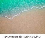 soft wave of ocean on sandy... | Shutterstock . vector #654484240