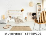 little girl in white... | Shutterstock . vector #654489103