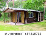Tiny Wooden Cabin House With...