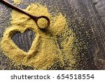wooden spoon with amaranth... | Shutterstock . vector #654518554