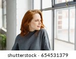 pensive attractive young... | Shutterstock . vector #654531379