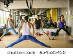 group of people workout in... | Shutterstock . vector #654535450
