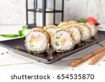 hot fried sushi roll with... | Shutterstock . vector #654535870