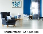 blue and white living room with ...