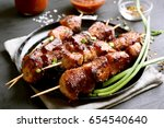 grilled meat on wooden skewers...   Shutterstock . vector #654540640