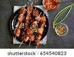 bbq meat on wooden skewers on... | Shutterstock . vector #654540823