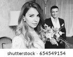 meeting the bride and groom ... | Shutterstock . vector #654549154