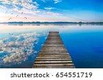 EBirds fly over empty footbridge. The lake Selment Wielki, Masuria, Poland. - stock photo