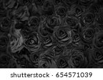 black rose background. | Shutterstock . vector #654571039