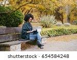 stylish black female... | Shutterstock . vector #654584248