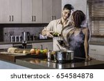 young mixed race couple cooking ... | Shutterstock . vector #654584878