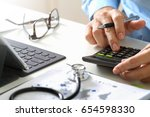 healthcare costs and fees... | Shutterstock . vector #654598330
