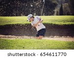 young girl playing golf on a... | Shutterstock . vector #654611770