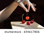 a female hand is selecting a... | Shutterstock . vector #654617806