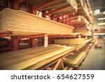 blurred wooden bars from floor... | Shutterstock . vector #654627559