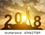 man hand up on the peak of...   Shutterstock . vector #654627589