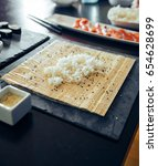 sushi on a plate being rolled | Shutterstock . vector #654628699