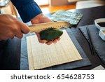 fresh avocado being cut in half | Shutterstock . vector #654628753