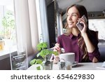 woman at the cafeteria speak on ... | Shutterstock . vector #654629830