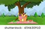 wicker picnic basket full of... | Shutterstock .eps vector #654630910