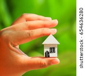 woman hands holding house model ... | Shutterstock . vector #654636280